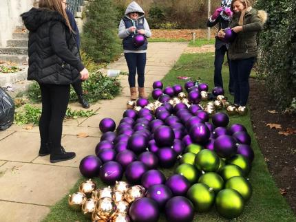 Highbury College floristry students working together at Mottisfont