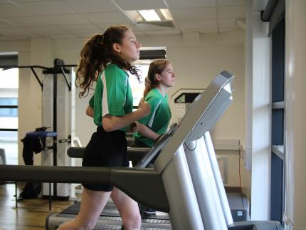 Public services student on treadmill