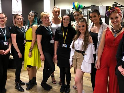 Hairdressing and beauty models with their student stylists in a salon