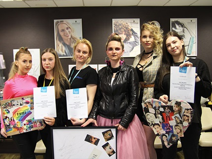 Winners of the Highbury College Level 2 Hairdressing morning competition with their models and certificates