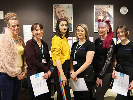 Winners of the Highbury College Level 2 Hairdressing afternoon competition with their models and certificates