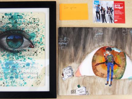 Highbury College My Dog Sighs Art & Design Competition first place artwork and prize on a table