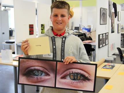 Highbury College My Dog Sighs Art & Design Competition second place winner holding their artwork