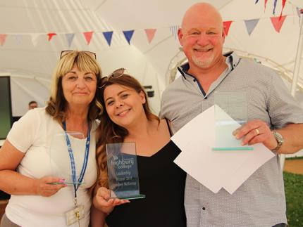 Staff members holding their awards at the Highbury College Star Awards