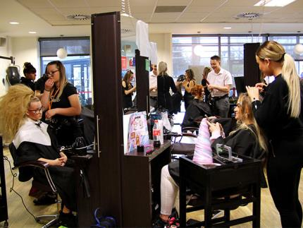 A busy college hairdressing salon