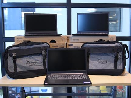 Highbury College laptops and laptop cases on a table