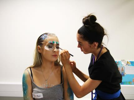 Highbury College beauty student applies make-up on model during competition heat