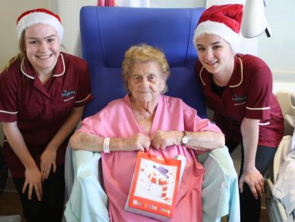 Health and social care students Christmas presents to give to patients at QA hospital in Portsmouth