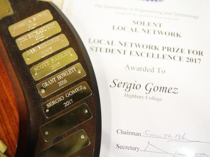 Sergio Gomez engraved on the Student Excellence Award for 2017