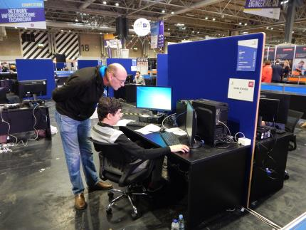 Students competing in the finals of the WorldSkills competition at the Birmingham NEC