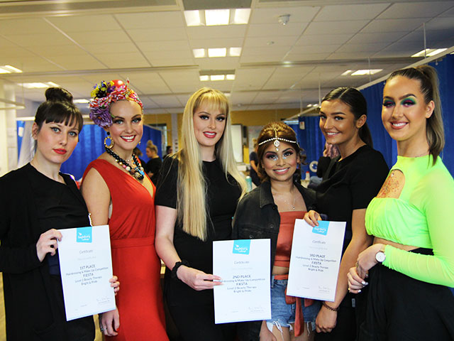Winners of the Highbury College Level 2 Beauty Therapy morning competition with their models and certificates