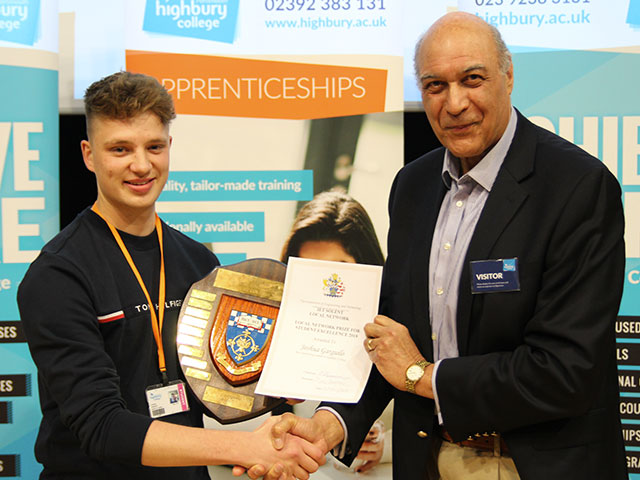 Highbury College apprentice Josh Garguilo receiving an award from Chairman of the RMS of the IET Solent region Peter Bennison