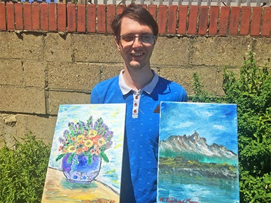 Highbury student Michael with his paintings