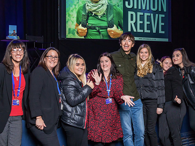 Travel TV presenter Simon Reeve with Highbury College staff and students inside Portsmouth Guildhall