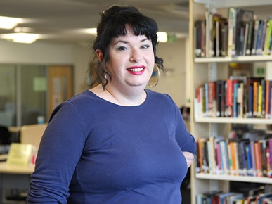 Profile photo of Highbury student Louise in a library