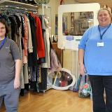 Former Highbury Prospects student Sarah standing near Naomi House & Jacksplace, Cosham Shop Manager Andrea Pledge in the charity shop
