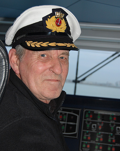 George Terry wears the captains cap on his last commute to Highbury College before retirement