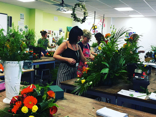 Floristry students creating floral arrangements for Portsmouth