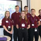 Highbury Public Services students standing in front of their road safety presentation
