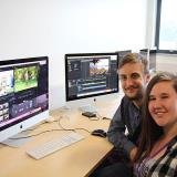 Sam Mcculloch and Lauren Townsend sat in front of iMacs, editing their video footage